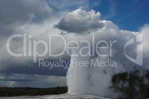 Old Faithful Geysir and clouds, Yellowstone, Wyoming