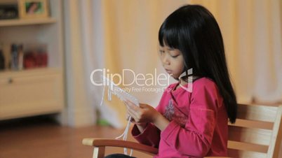 Girl Enjoys Stitching In Her Rocking Chair