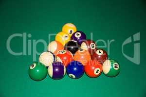 Billiard balls - pool, on a green table.