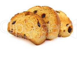 A tasty biscuit with raisins on a white background.