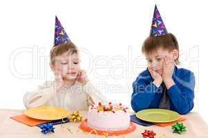 two boy wich cake