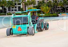 Sweeping and raking sand on beach