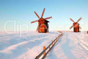 The old wooden windmills during sunset, Cherkasi region, Vodyani