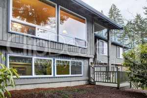 Split level brown grey house front exterior.