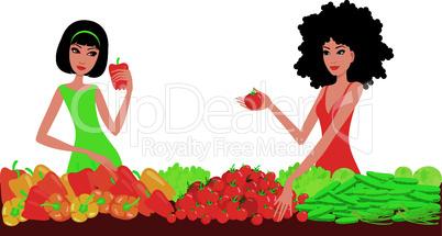 Two women buy vegetables