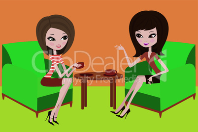 Two young women talk in armchairs