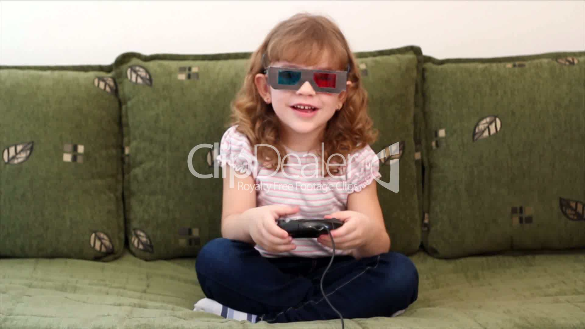little girl with 3d glasses play video game royalty free video and stock footage. Black Bedroom Furniture Sets. Home Design Ideas