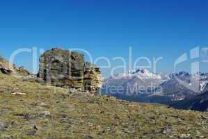 Rock formation with view on high Rocky Mountain peaks, Colorado