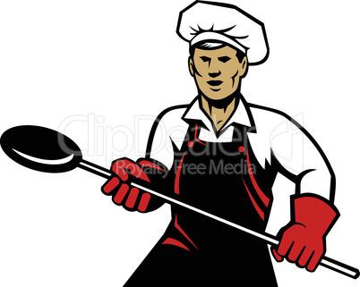 baker with a baking pan retro
