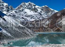 Sacred Lake and mountain peaks near Gokyo in Himalayas