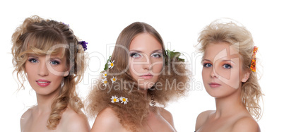 Three young naked women with flower hair style