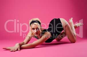 cute woman sexy posing in black sport suit on pink