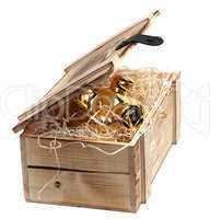 golden piggybank in box with wood-wool