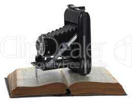 historic camera on old book