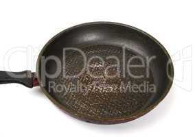 Dirty old frying pan on white background
