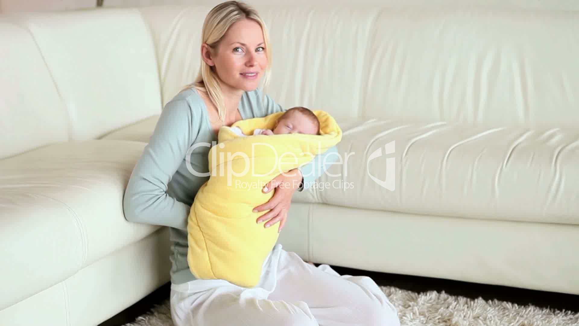 junge mutter mit baby royalty free video and stock footage. Black Bedroom Furniture Sets. Home Design Ideas