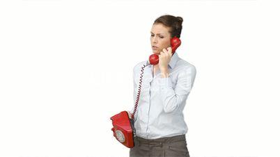 Junge Frau mit rotem Telefon