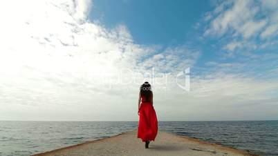 Woman In Red Dress Walking Down Pier