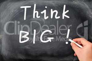 Think big written on a blackboard