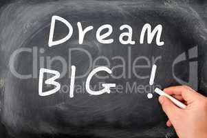Dream big written with chalk on a blackboard background