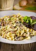 Tagliatelle with tail steak stripe and champignons