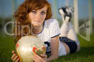 Healthy beautiful girl with freckles on soccer field