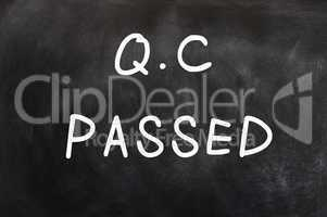 QC passed written on a chalkboard