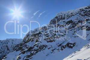 Sun and snow-capped peaks