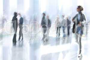 motion blurred business people