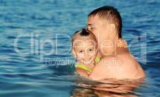 Dad and daughter swimming in the sea