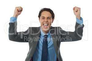 Excited businessman rasing his arms and cheering joyfully