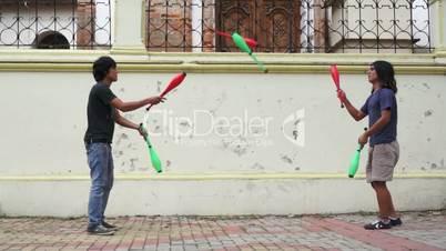 Two Street Jugglers Practicing