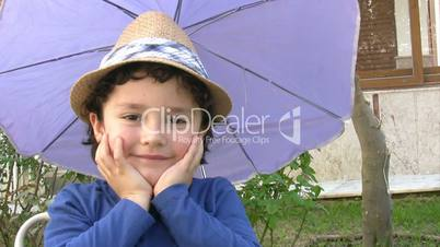 Little boy gives salute to camera