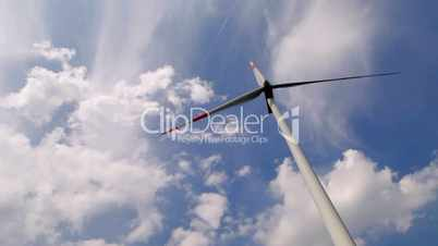 Modern wind energy turbine power station under blue sunny sky with many clouds, timelapse 1080p full HD