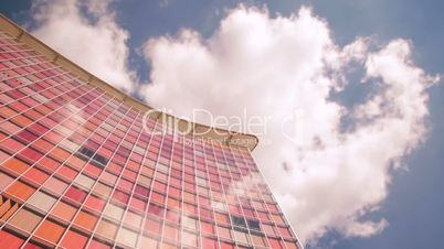 Modern moving Corporate building and time lapse clouds. HD 1080