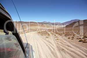 Cars on the desert road