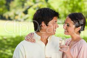Woman looking at her friend while holding a glass of champagne