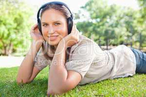 Woman listening to music on the lawn
