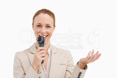 Portrait of a businesswoman speaking with a microphone
