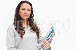 Brunette holding files