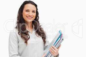 Portrait of brunette holding files