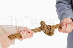 Business people tightening a knot