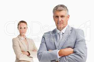 Two business people with folded arms