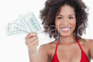 Bank notes being held by an attractive woman