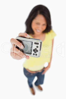 Young woman taking a picture of herself