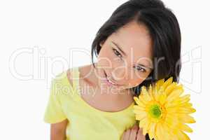 High-angle view of a Latino woman holding a gerbera