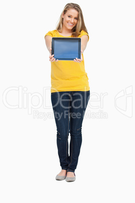 Blonde woman smiling while showing a touch pad screen