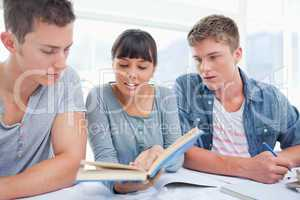 A group of students work together as the girl reads out an answe