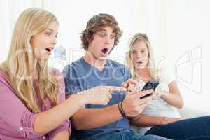 Three friends shocked at the message on the phone