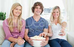 Three friends enjoying popcorn together